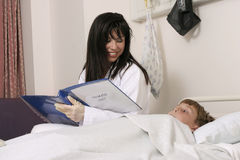 Doctor and child. Doctor eases a child's worries Royalty Free Stock Image