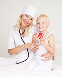 Doctor and child Stock Images