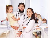 Doctor with child in hospital. Stock Photos