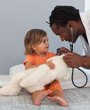 Doctor with a child in a hospital Royalty Free Stock Photos