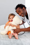Doctor with a child in a hospital Stock Photography