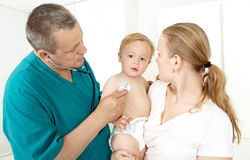 Doctor, child, mother Stock Images