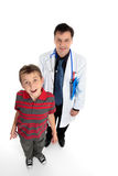 Doctor with child patient stock photography