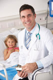 Doctor with child patient in USA A&E Royalty Free Stock Photos