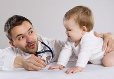 Doctor and child Royalty Free Stock Photography
