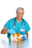 Doctor choosing prescription from bin Stock Photos
