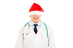 Doctor in Christmas hat stretched over his eyes Royalty Free Stock Photography