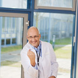 Doctor Clenching Fist While Celebrating Victory Stock Photos