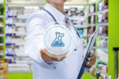 Doctor clicks on the icon of the drug . royalty free stock photo
