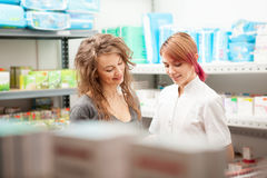 Doctor and client in the warehouse Stock Image