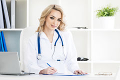 Doctor in clinical office Stock Image