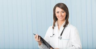 Doctor with clipboard Royalty Free Stock Images