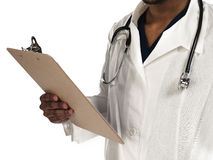 Doctor with clipboard. Close up of a doctors hand holding a clipboard Stock Photo