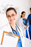 Doctor with clipboard Stock Photography