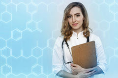 Doctor with clipboard and formulas Stock Photography