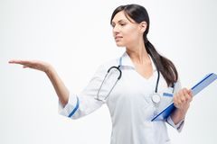 Doctor with clipboard holding copyspace on her palm Stock Photography