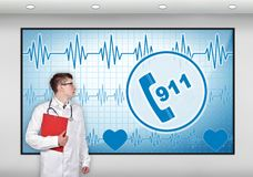 Doctor with clipboard. Looking to screen with 911 symbol Royalty Free Stock Photography