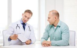 Doctor with clipboard and patient in hospital Stock Image
