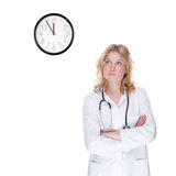 Doctor with clock Royalty Free Stock Photo