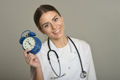 Doctor with clock Stock Photo