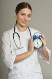 Doctor with clock Royalty Free Stock Images