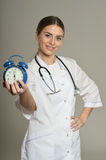 Doctor with clock Stock Image
