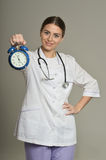 Doctor with clock Royalty Free Stock Image