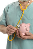 Doctor close up with stethoscope and piggy bank Royalty Free Stock Photos