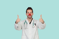 Doctor with a clown nose saying Ok Royalty Free Stock Photo