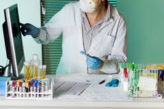 Doctor coding tubes sample for study Royalty Free Stock Images
