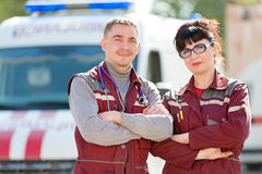 Doctor with colleague paramedic on ambulance vehicle background Royalty Free Stock Images