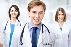 Doctor with colleagues Royalty Free Stock Image