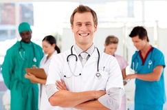 Doctor with colleagues in the background Royalty Free Stock Photos
