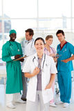 Doctor with colleagues in the background Royalty Free Stock Image