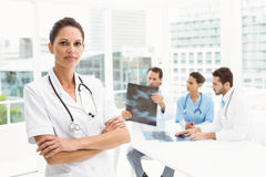 Doctor with colleagues examining x-ray in medical office Royalty Free Stock Photography