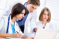 Doctor and collegues Royalty Free Stock Photography