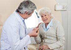Doctor Comforting Senior Female Patient Royalty Free Stock Photos