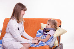 Doctor comforting a sick child Stock Photos