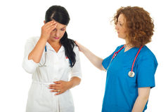 Doctor comforting sick colleague Stock Images