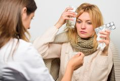 Doctor communicate with patient recommend treatment. Doctor ask patient about symptoms. Flu and cold treatment. Girl in. Scarf examined by doctor. Cold and flu royalty free stock images