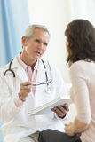 Doctor Communicating With Female Patient Royalty Free Stock Photo