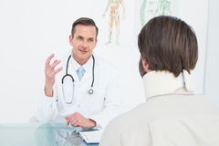 Doctor in communication with patient at medical office Stock Photos