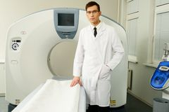Doctor and computed tomography scanner Stock Images