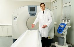 Doctor and computed tomography scanner Royalty Free Stock Photography