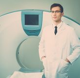 Doctor at the computed tomography Stock Images