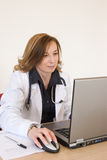 Doctor and computer Royalty Free Stock Photo