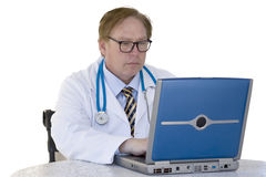 Doctor and Computer. A doctor working on his computer Royalty Free Stock Image