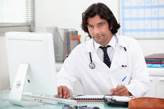 Doctor at a computer royalty free stock image