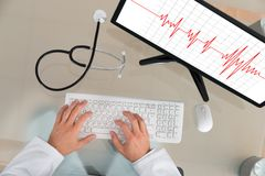 Doctor With Computer Showing Cardiogram Royalty Free Stock Photos