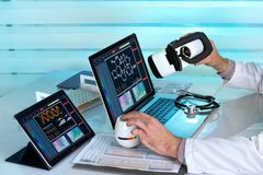 Doctor with computers and virtual reality vr headset working in royalty free stock photo